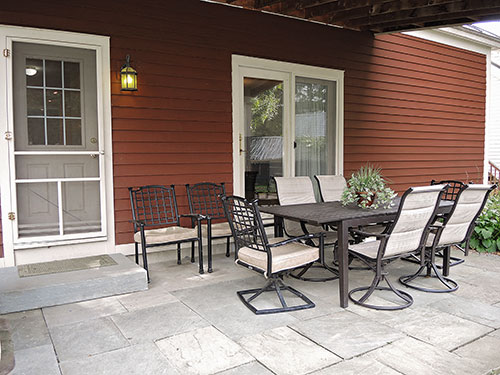 1825 Farmhouse outside dining on stone patio