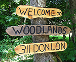 Adventure Woodlands welcome sign